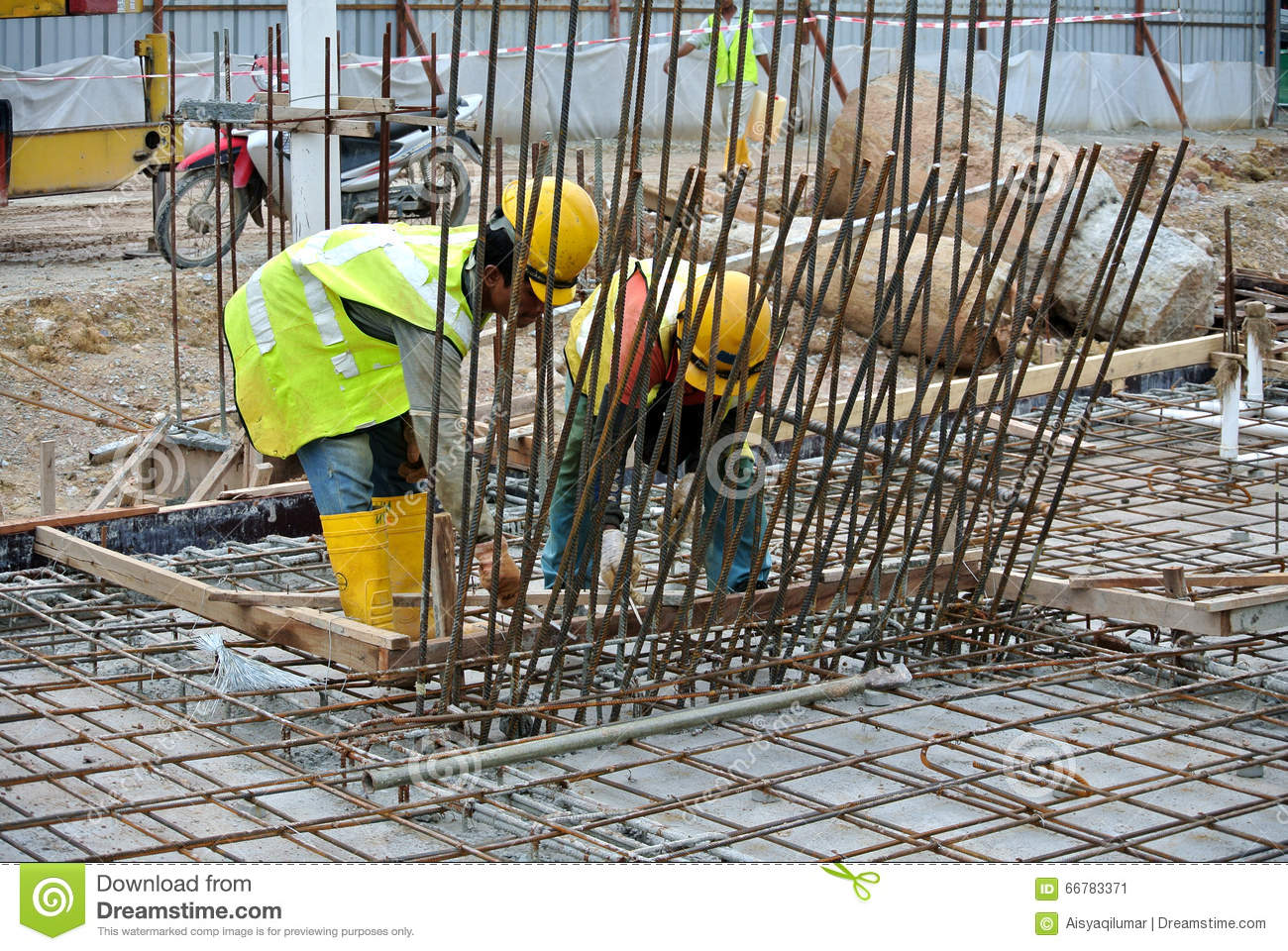 Construction Workers Fabricate Steel Reinforcement For