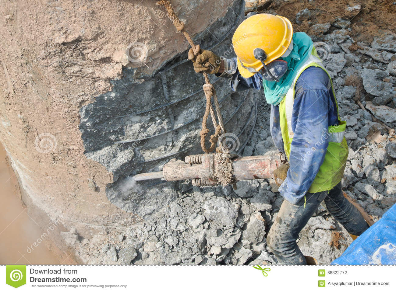 A construction workers hacking foundation pile editorial