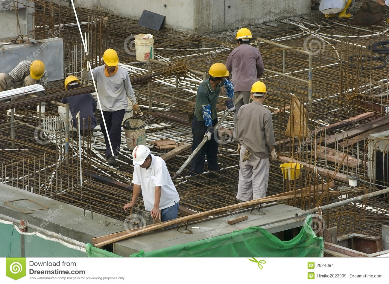 Construction workers at high rise building stock photo for Images of building sites