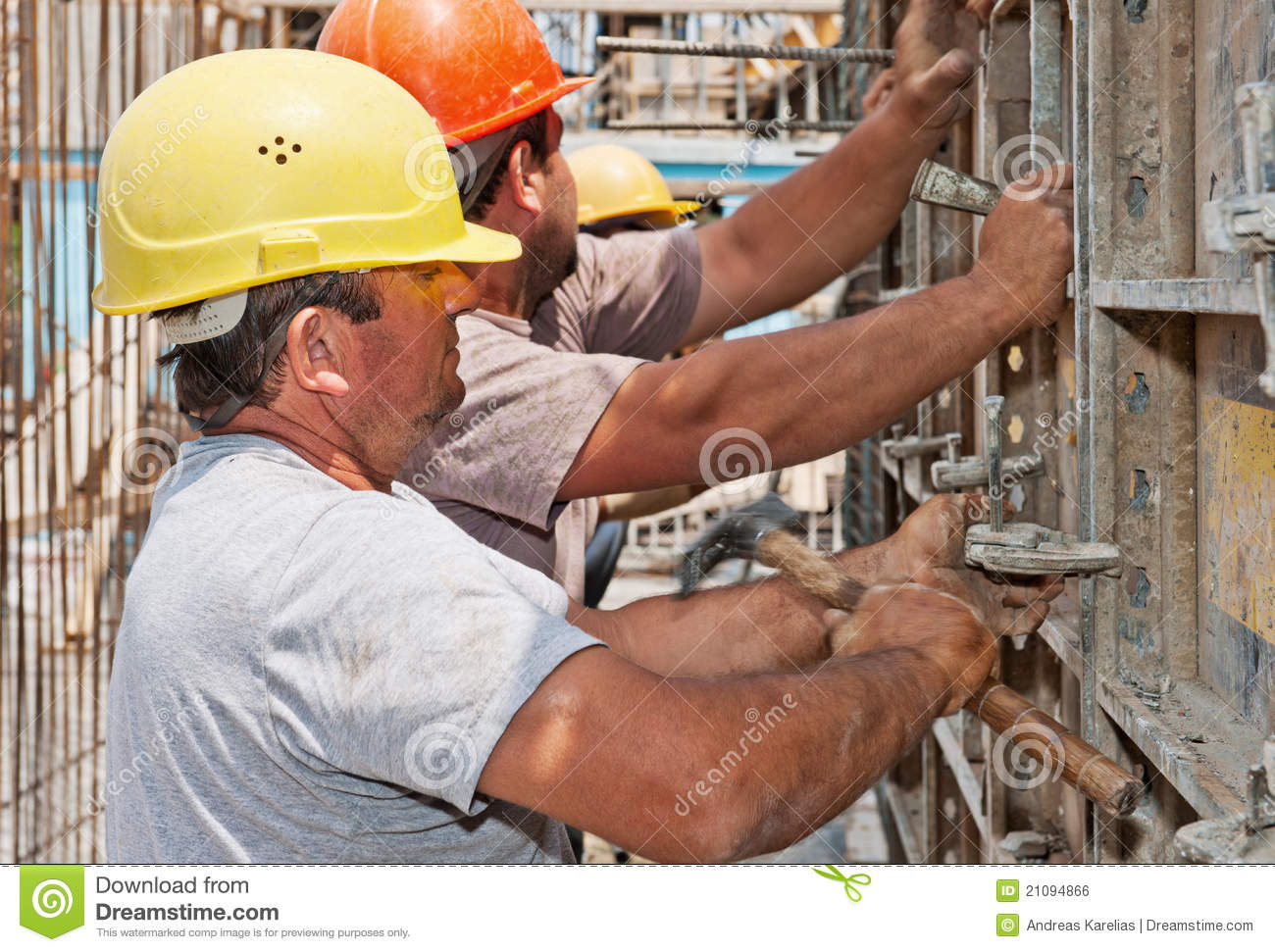 Construction workers positioning formwork frames