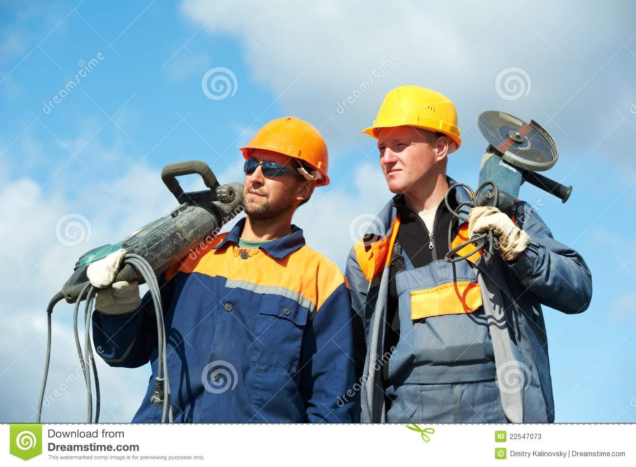 construction workers with power tools stock image