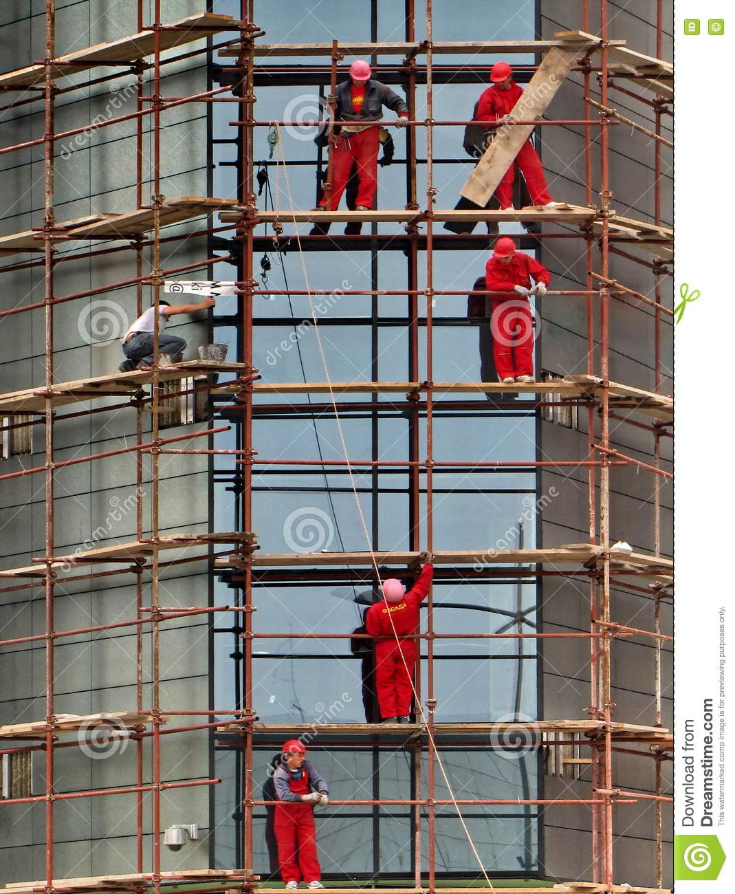 Working On Scaffolding : Construction workers on scaffolding editorial photography