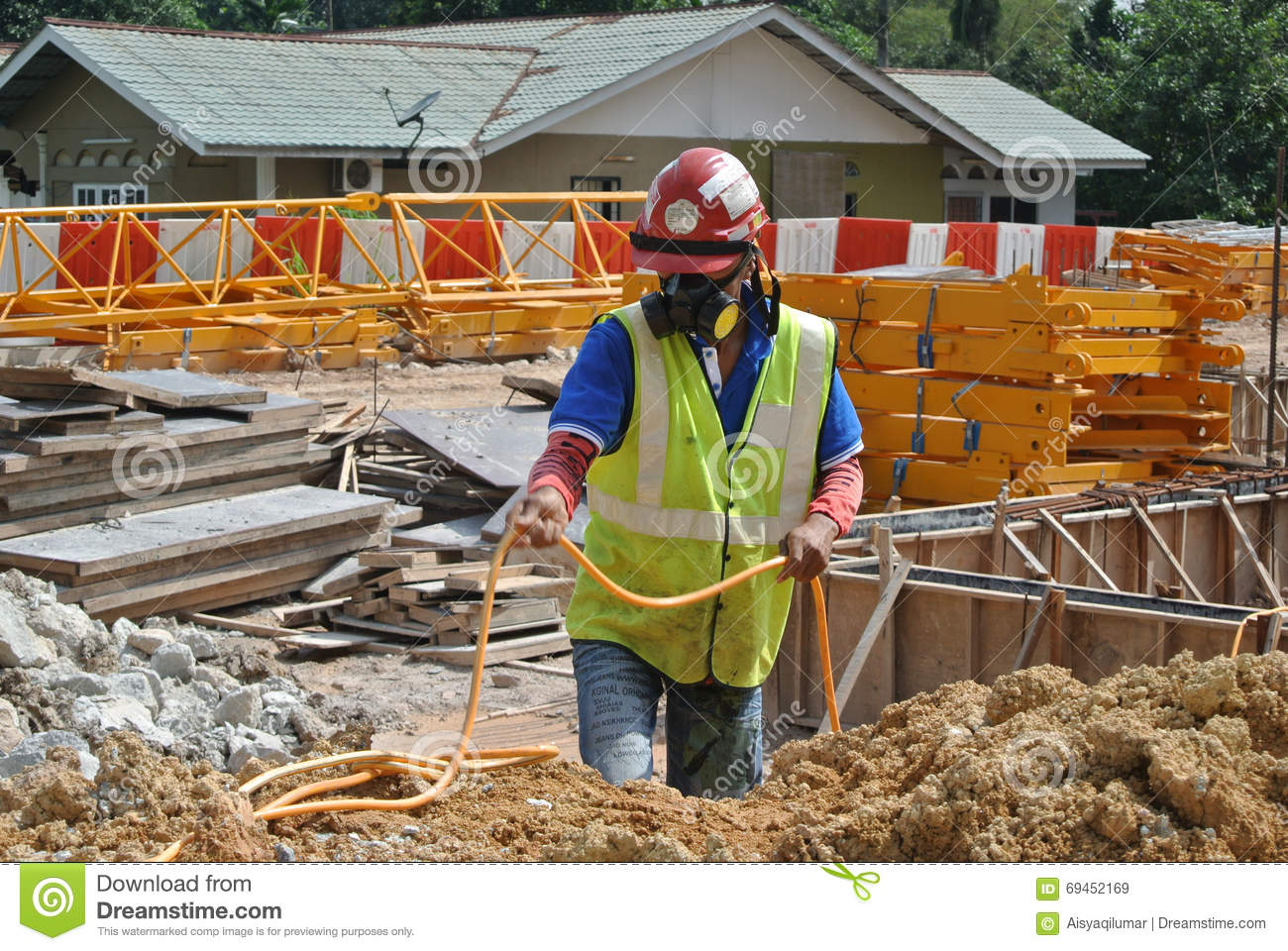 Construction Site Soil : Construction workers spraying the anti termite chemical