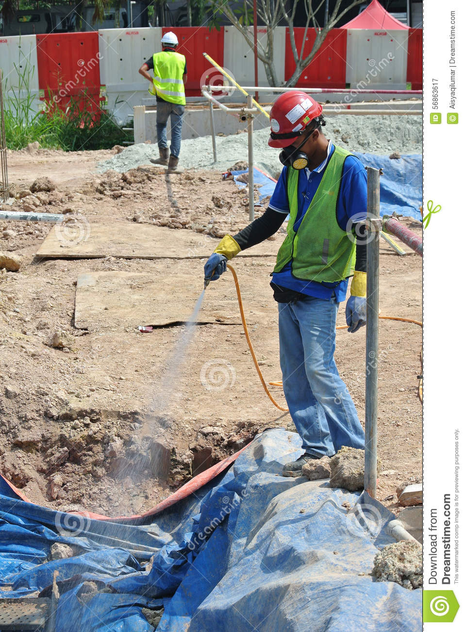 construction workers spraying the anti termite chemical treatment to the pile cap editorial. Black Bedroom Furniture Sets. Home Design Ideas