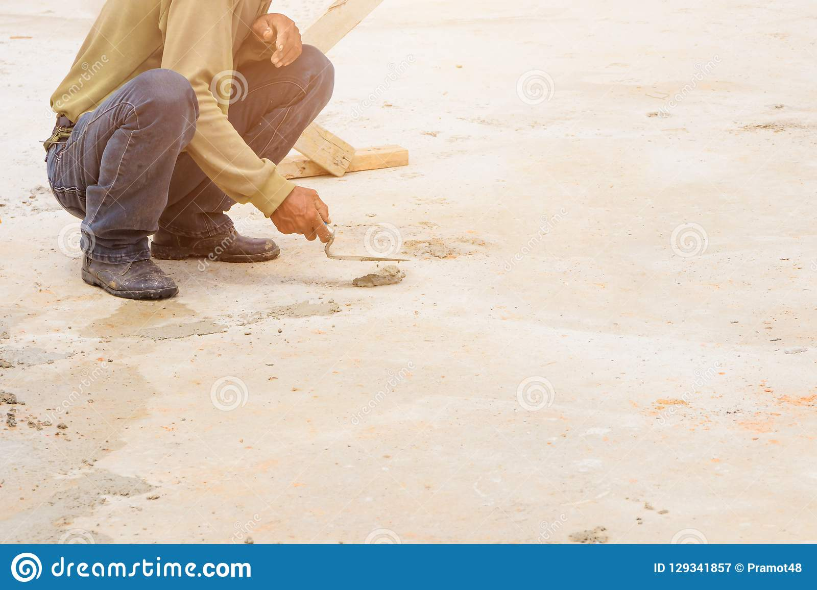 Construction workers were plastering repair floor in workplace build a house