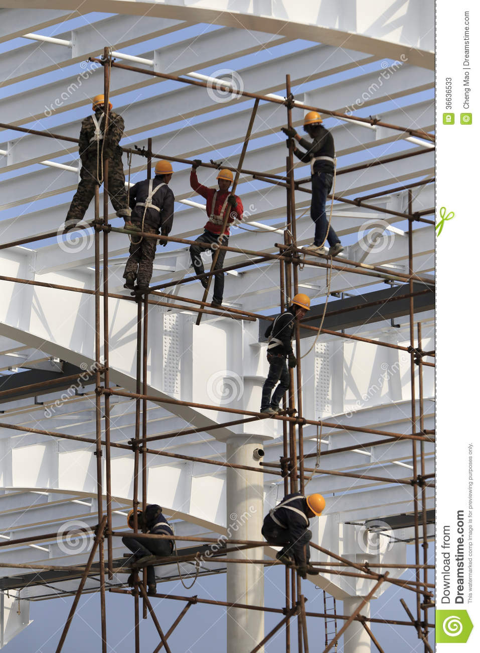 Construction Workers Working On Scaffolding Editorial