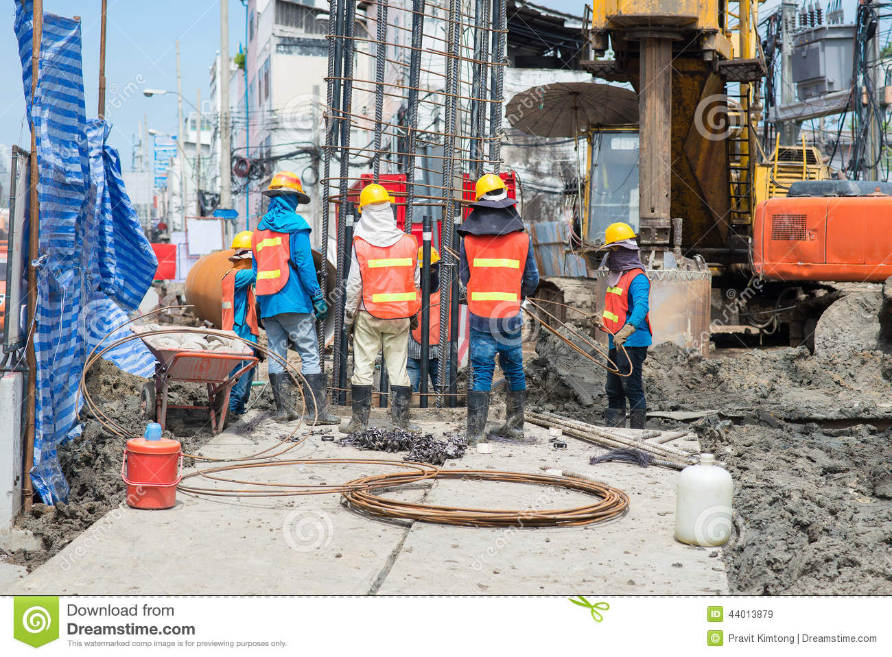 Construction workers working in site bridge piling