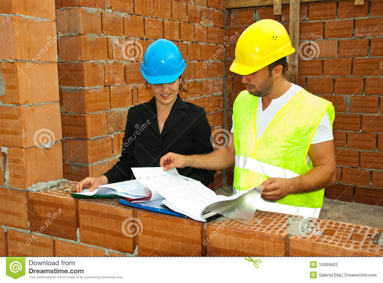 Constructions Workers Looking On House Plans Stock Photos   Image    Constructions workers looking on house plans
