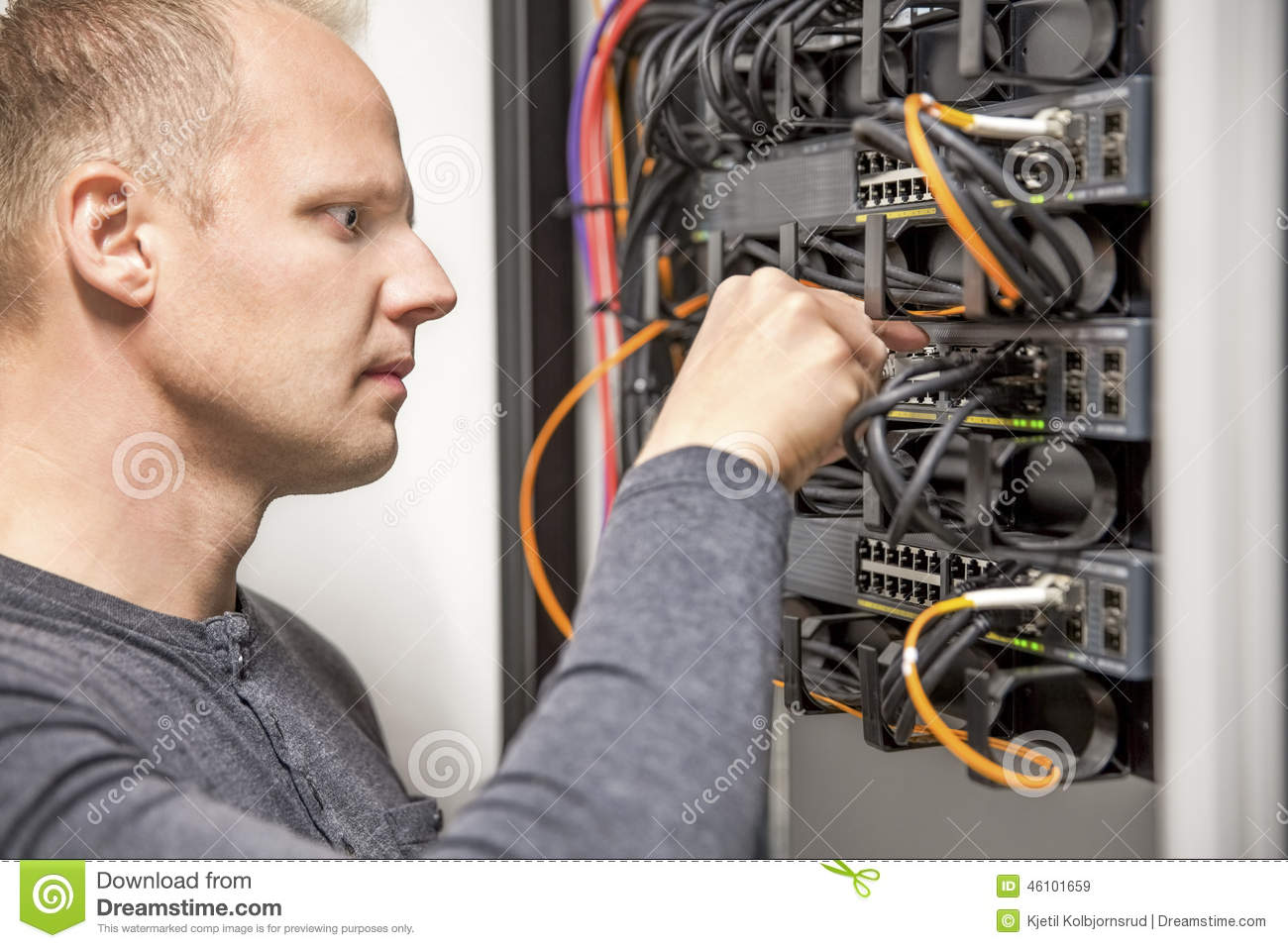 It Consultant Connecting Network Cable Into Switch Stock Image Wiring A