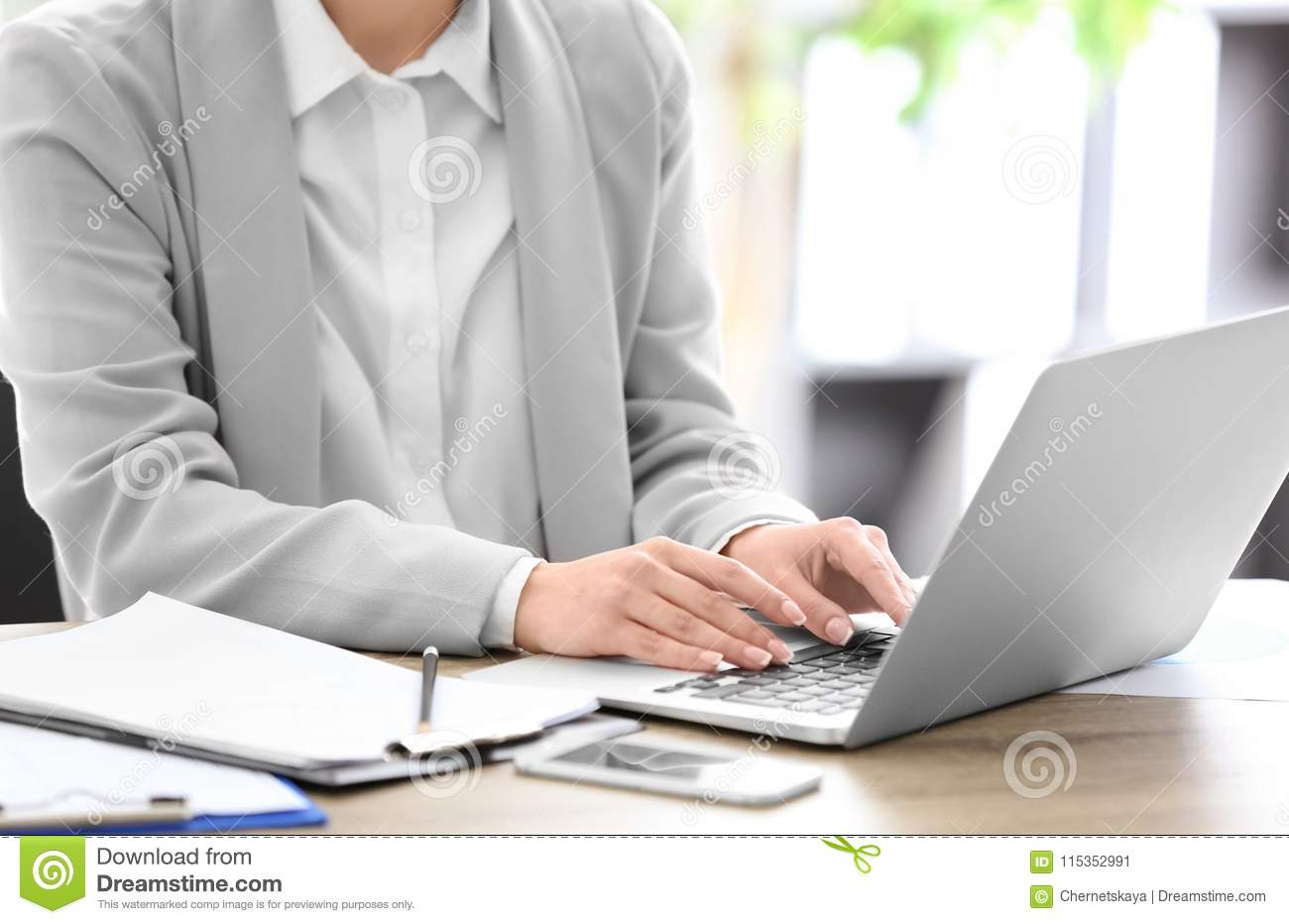 Consultant working at table in office,