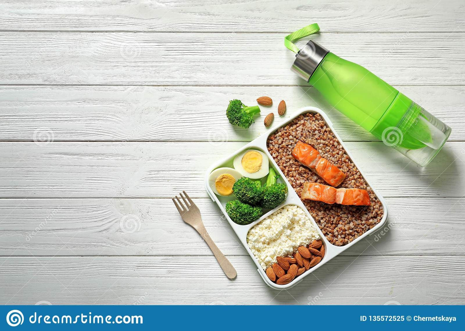 Container with natural healthy lunch, bottle of water and space for text on table, top view. High protein food