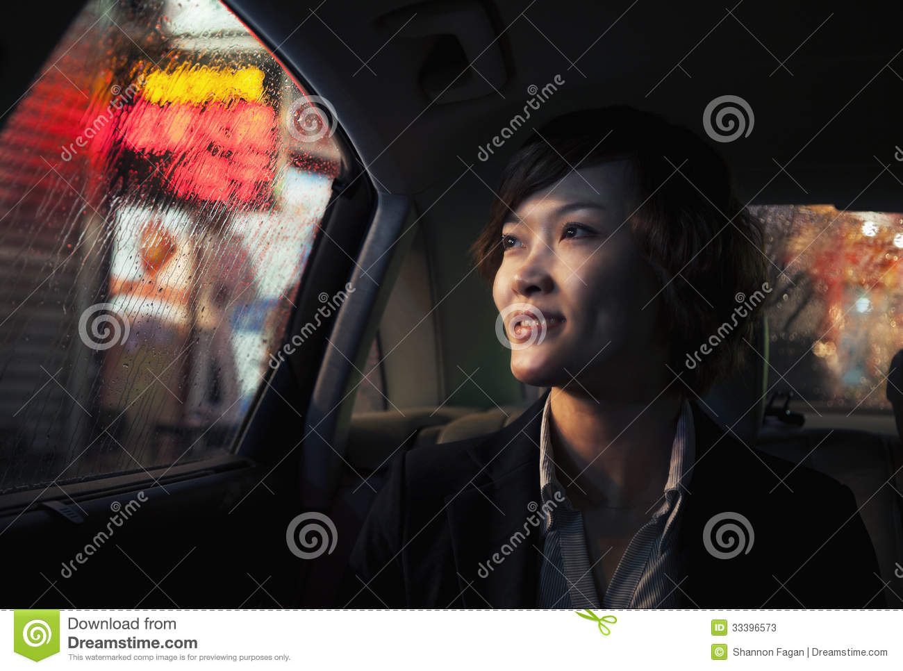 contemplative businesswoman looking out of car window through the rain at night in beijing stock. Black Bedroom Furniture Sets. Home Design Ideas