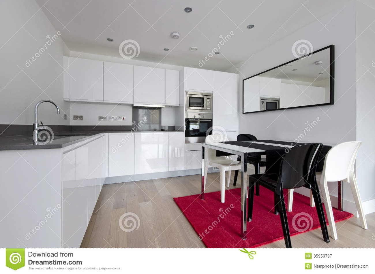 Contemporary Fully Fitted Kitchen In White Royalty Free