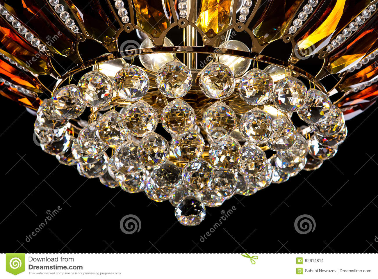 Contemporary Gold Chandelier Isolated On Black Background Crystal Decorated Amber Crystals Close Up