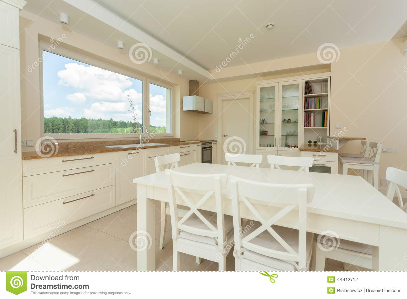 Contemporary Kitchen With Big White Table Stock Photo