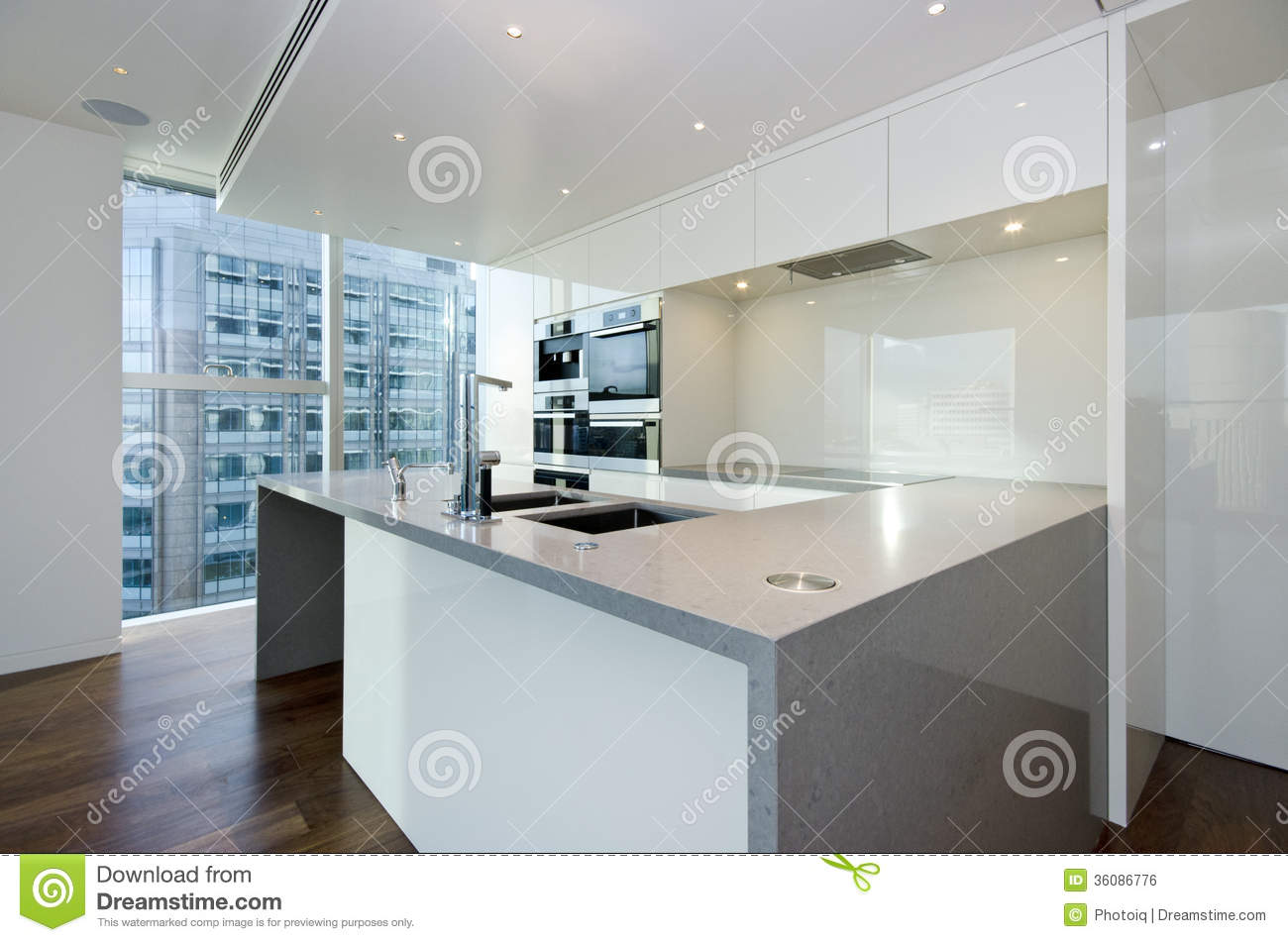 Contemporary kitchen with top spec appliances royalty free for Modern fitted kitchen
