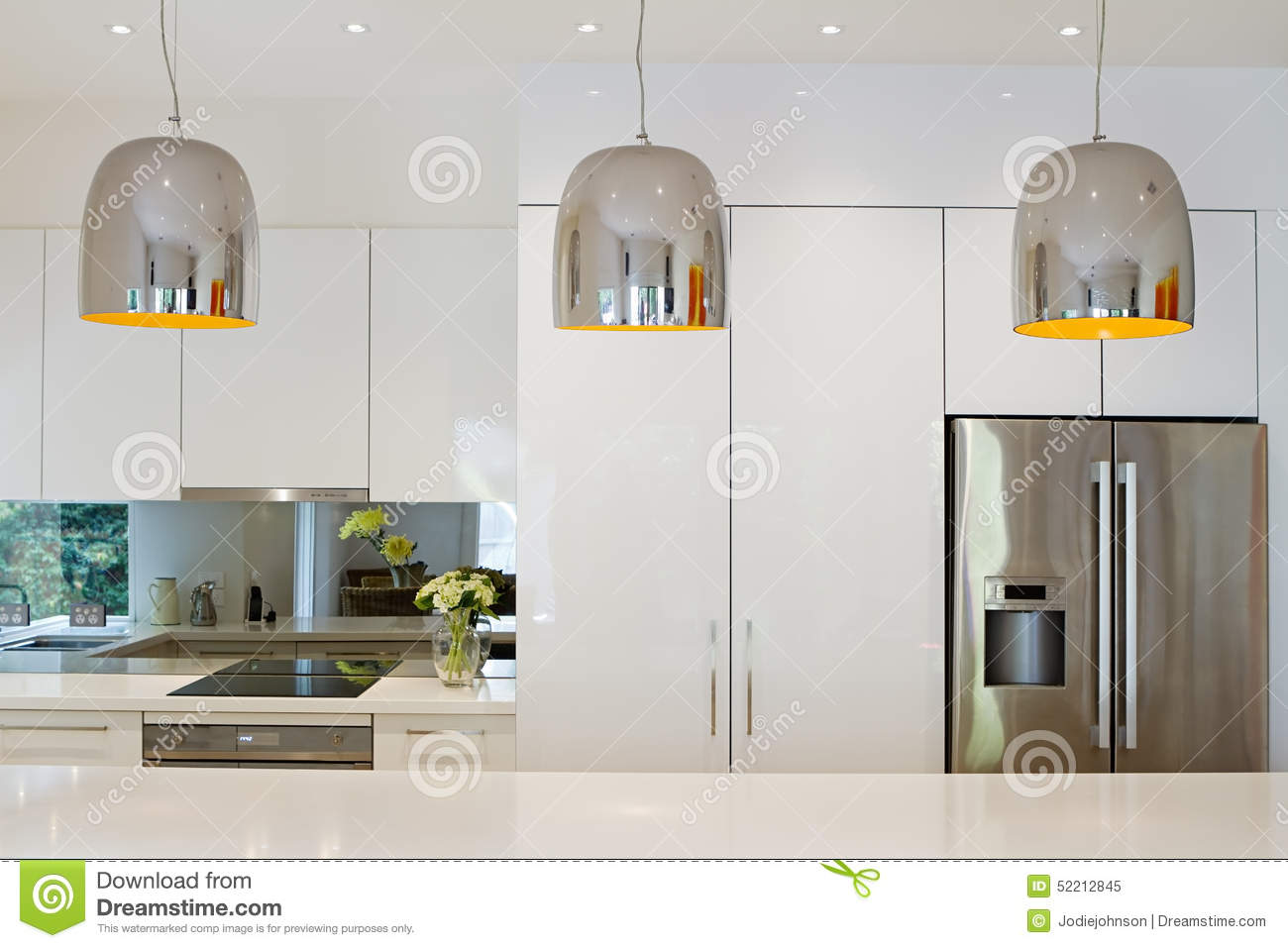 Contemporary Pendant Lights Hanging Over Kitchen Island
