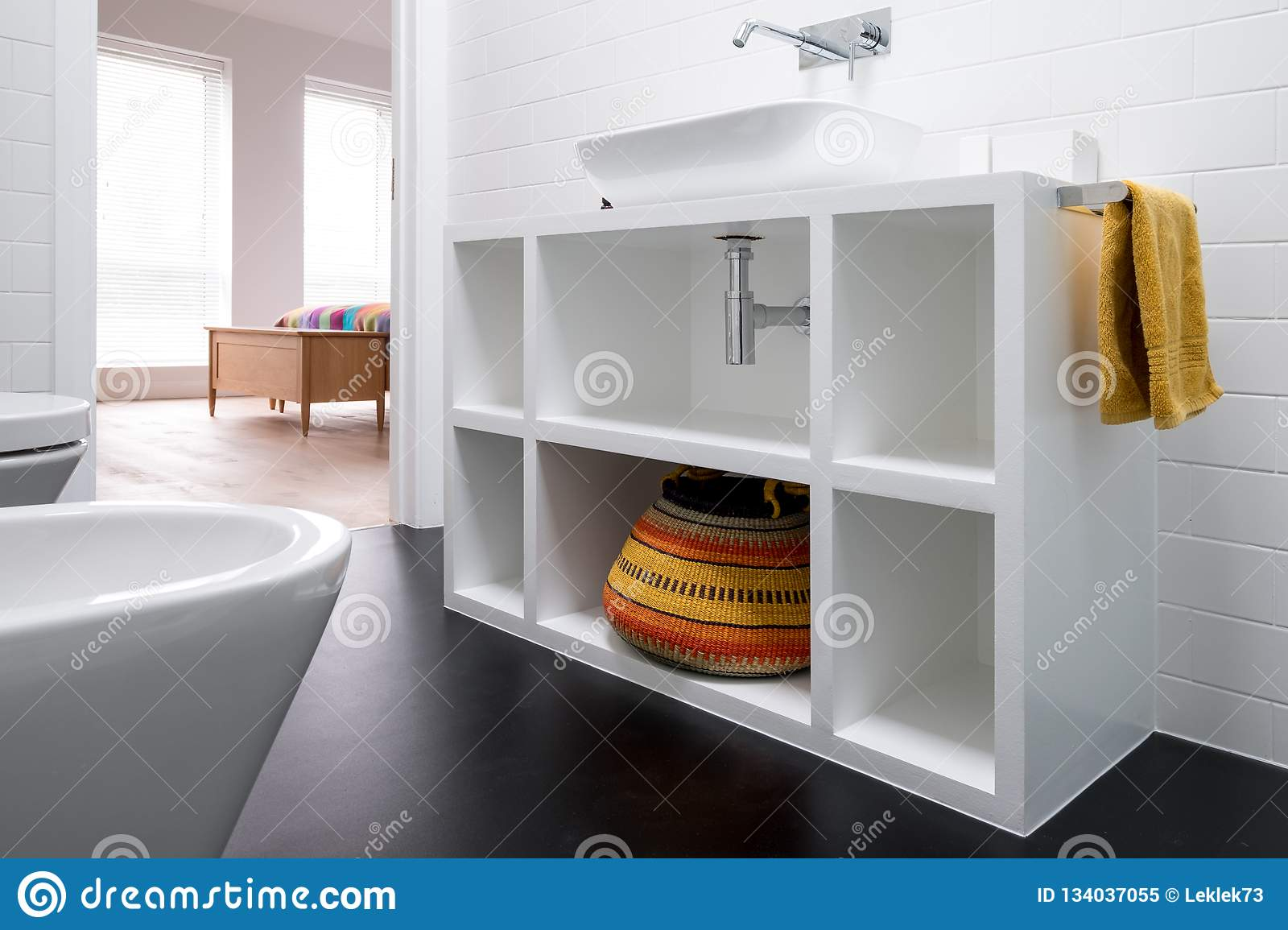 Contemporary White Painted Mdf Bathroom Unit With Colourful Basket And Black Vinyl Flooring Stock Image Image Of Colourful Flooring 134037055