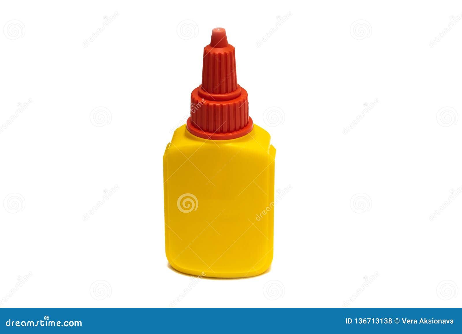Conteneur jaune avec la colle, isolat sur un fond blanc