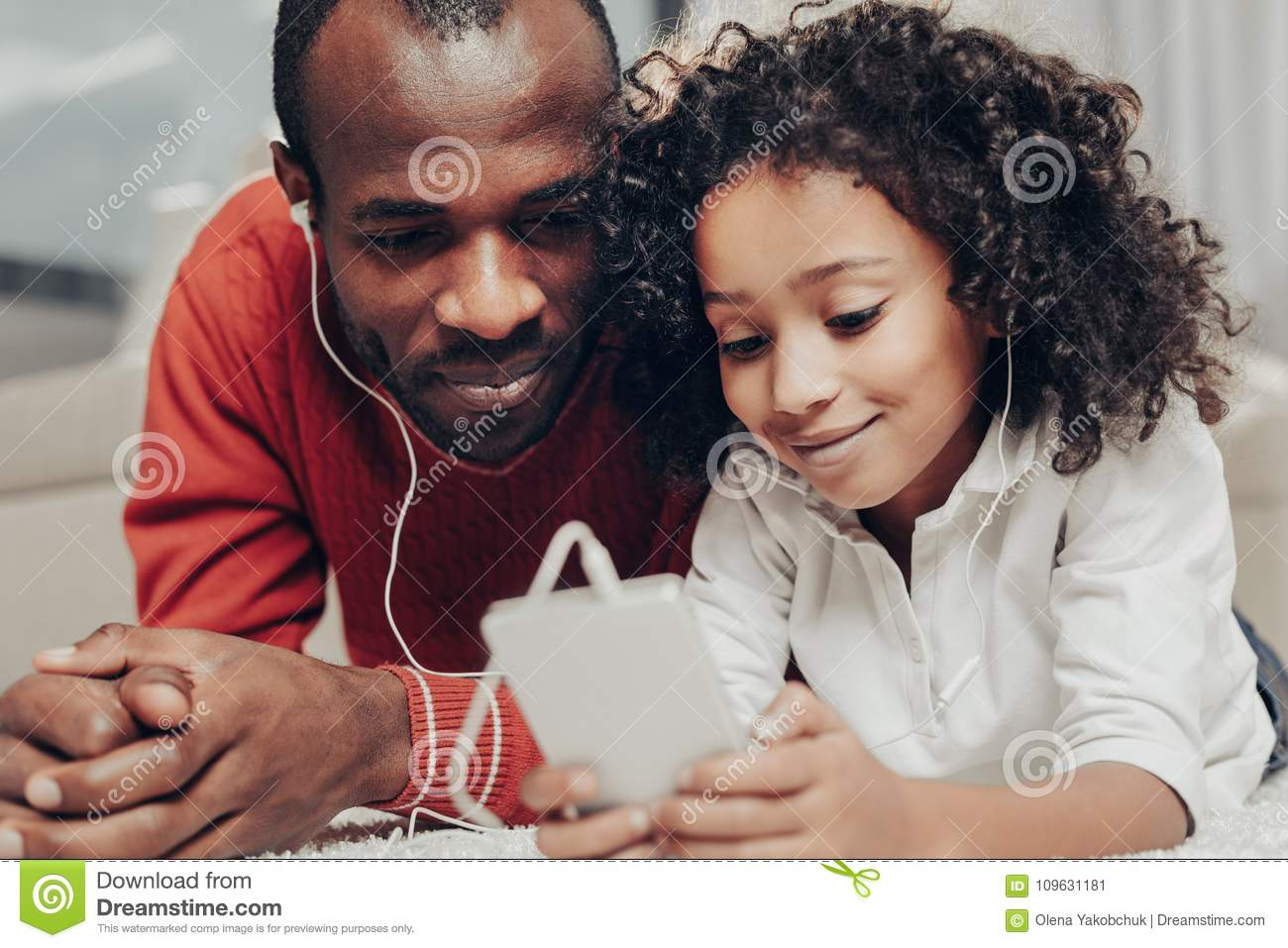 Download Satisfied Dad And Child Enjoying Melody With Earphones Stock Image - Image of earphone, fondness: 109631181