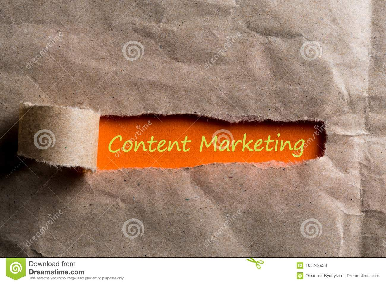Content Marketing Social Media Advertising Commercial Branding Concept. message appearing behind ripped brown paper.