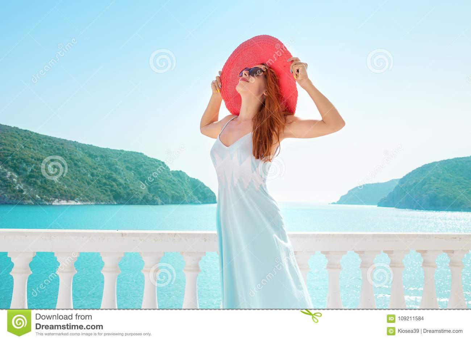 Content woman enjoying luxurious resort