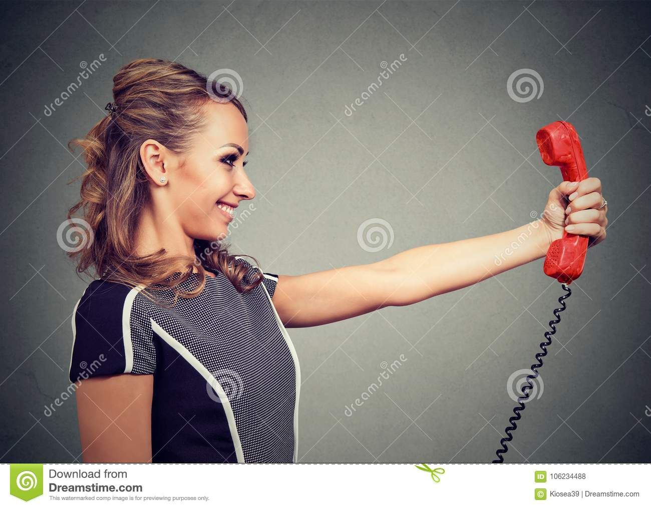 Content woman with red handset