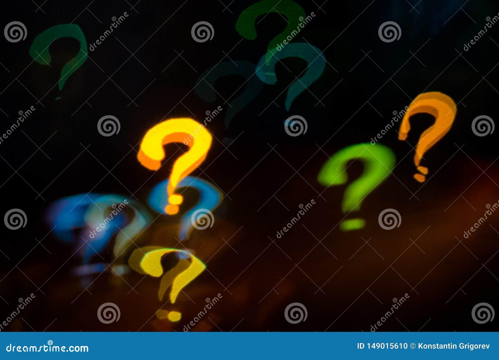 Contesto di Bokeh del punto interrogativo su fondo scuro
