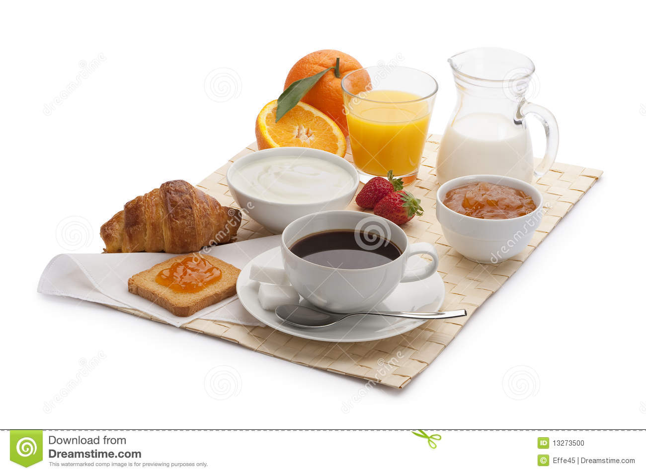 Continental breakfast with orange juice,strawberries, and a croissant.