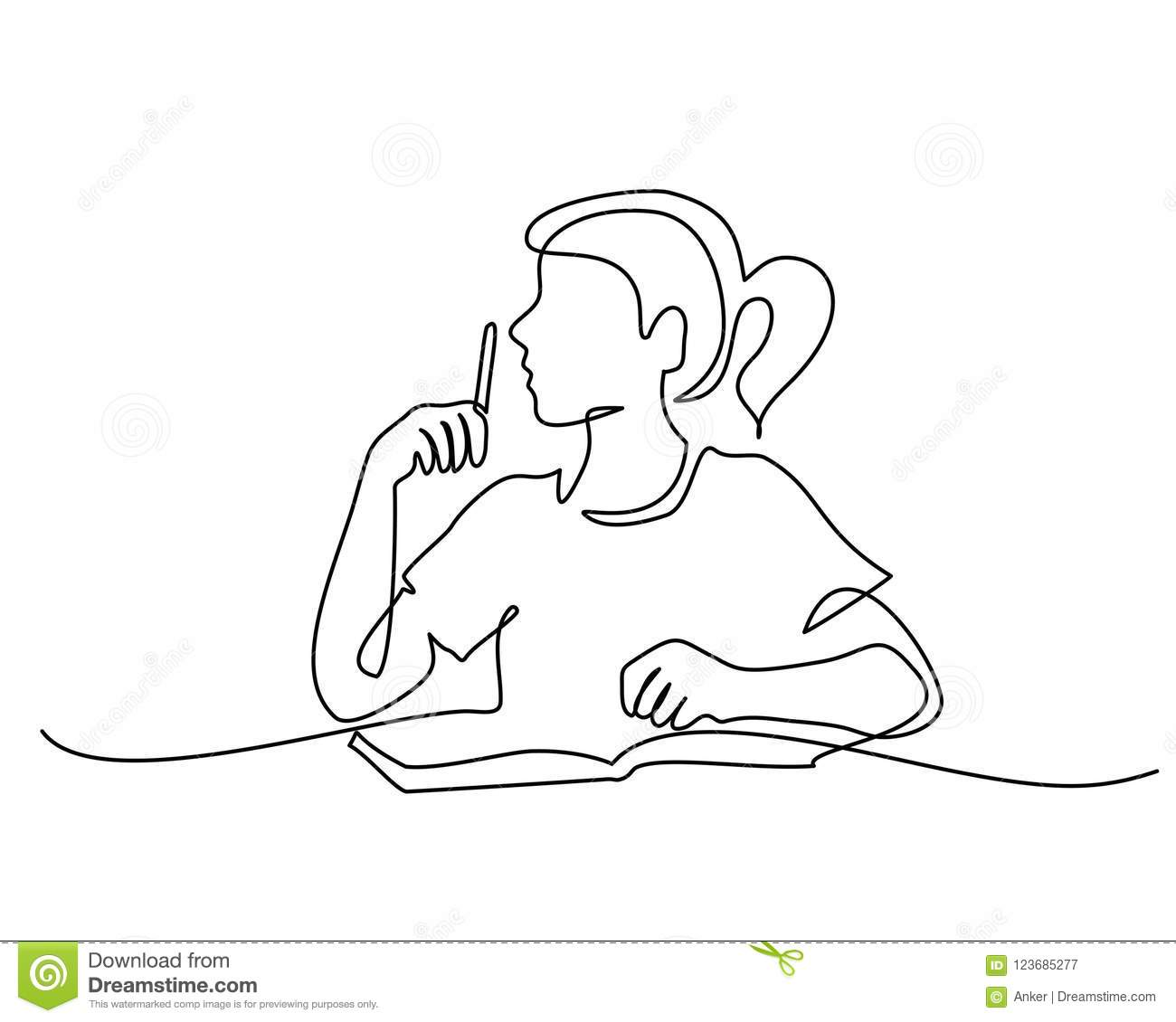 Schoolgirl sitting and writing with pencil on book