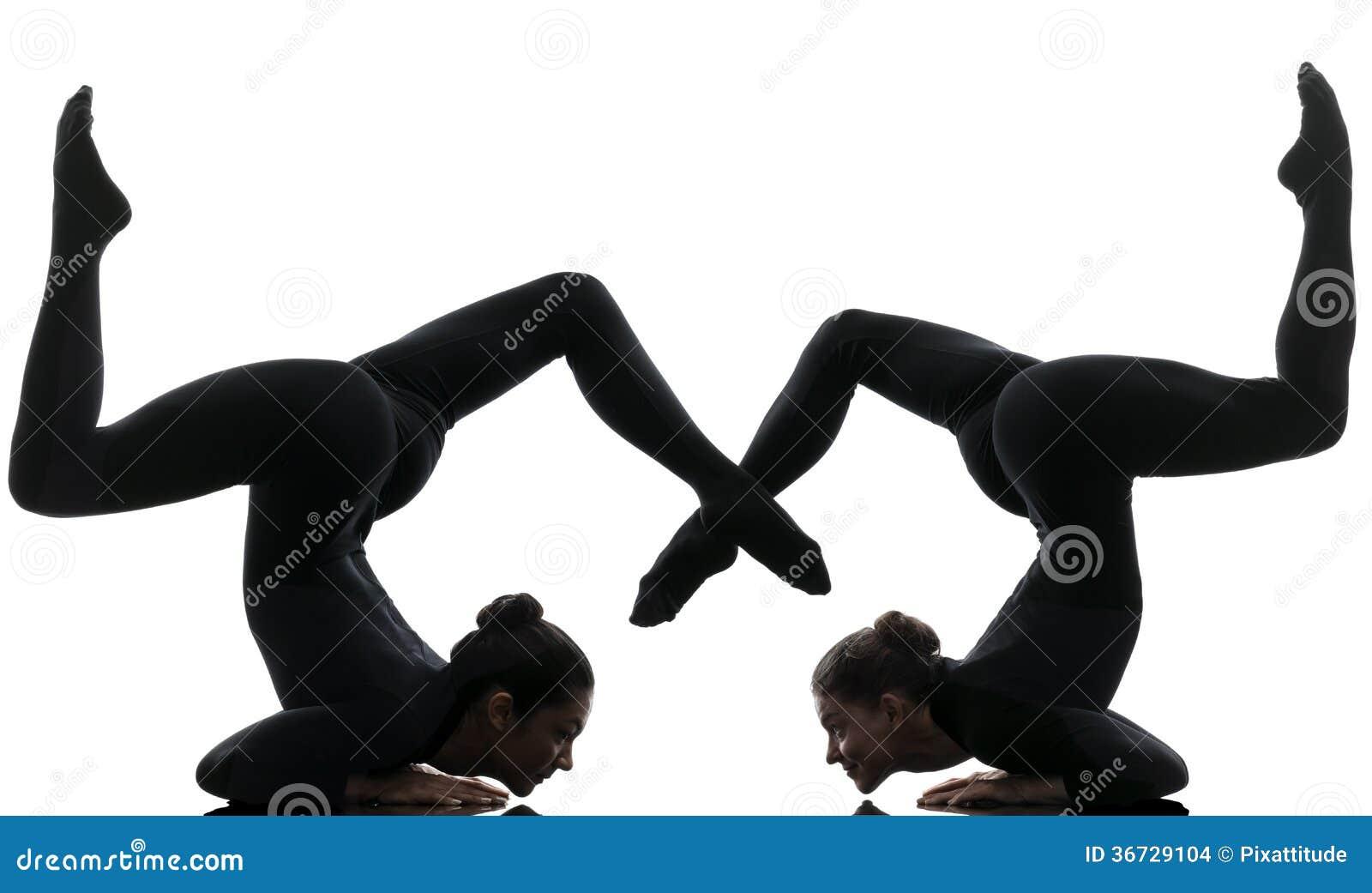 contorsionniste de deux femmes exer ant la silhouette gymnastique de yoga photo stock image du. Black Bedroom Furniture Sets. Home Design Ideas