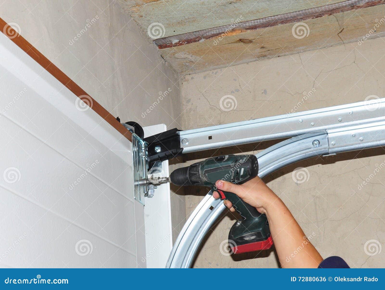 Man installing garage door stock photo for Man door in garage door
