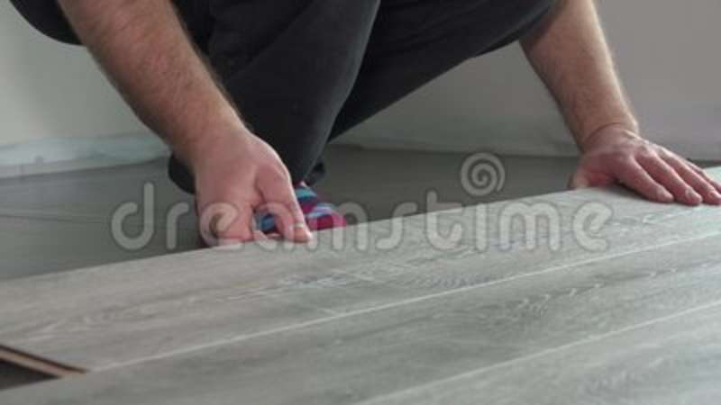 Contractor Installing Wooden Laminate Flooring With Insulation Stock