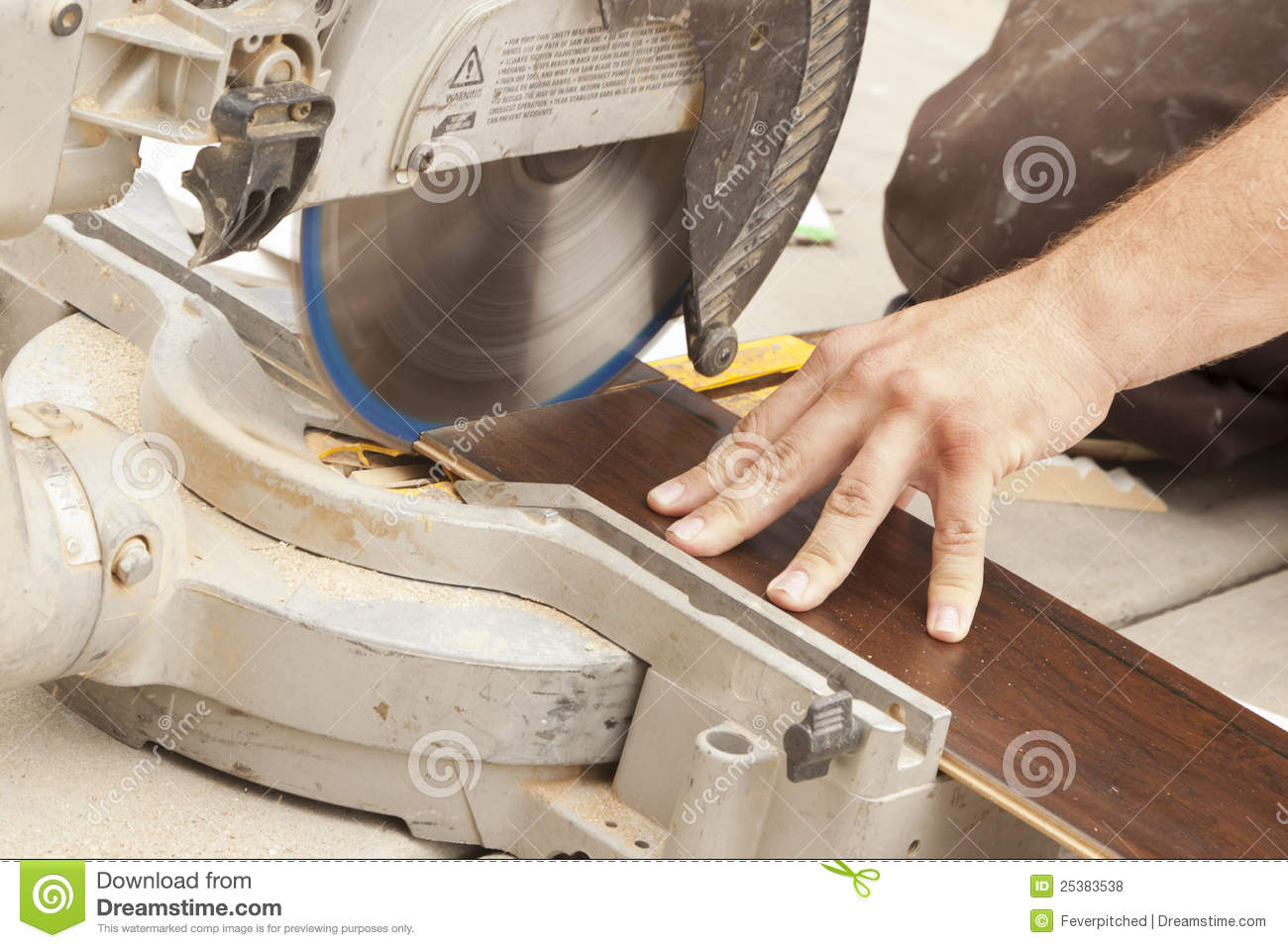 Contractor Using Circular Saw Cutting Of New Laminate Flooring