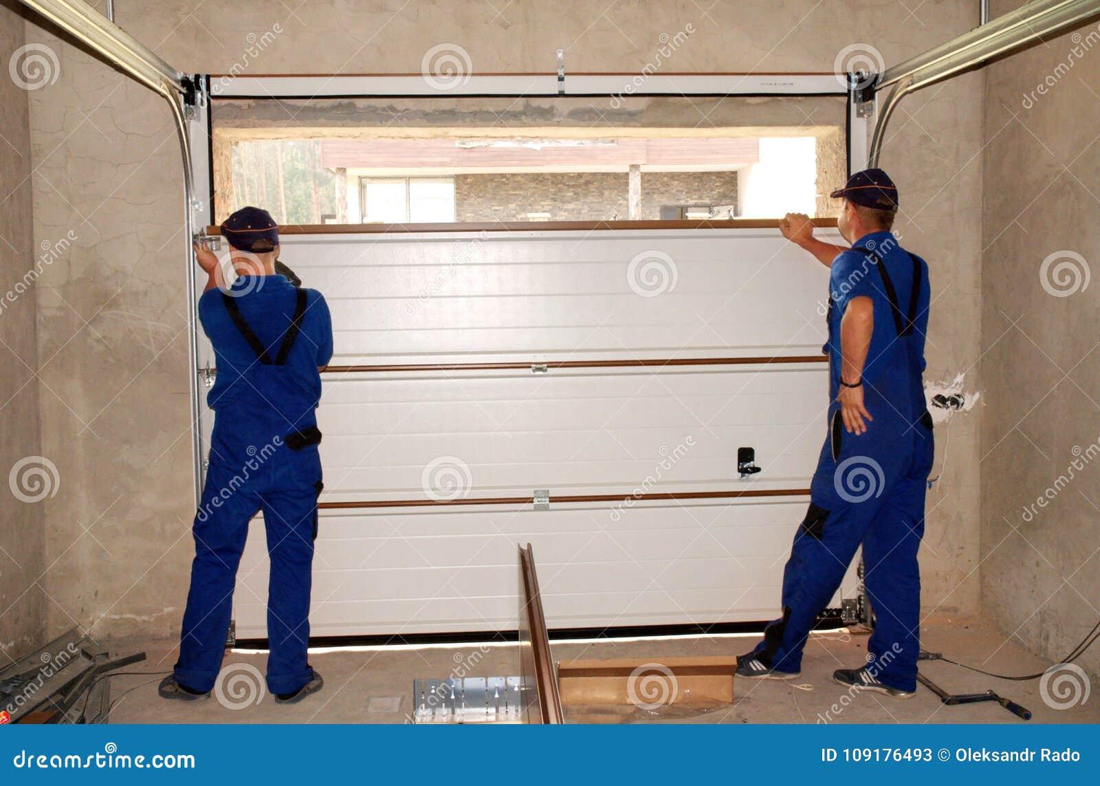 Contractors Installing Repair Insulating Garage Door Garage Door