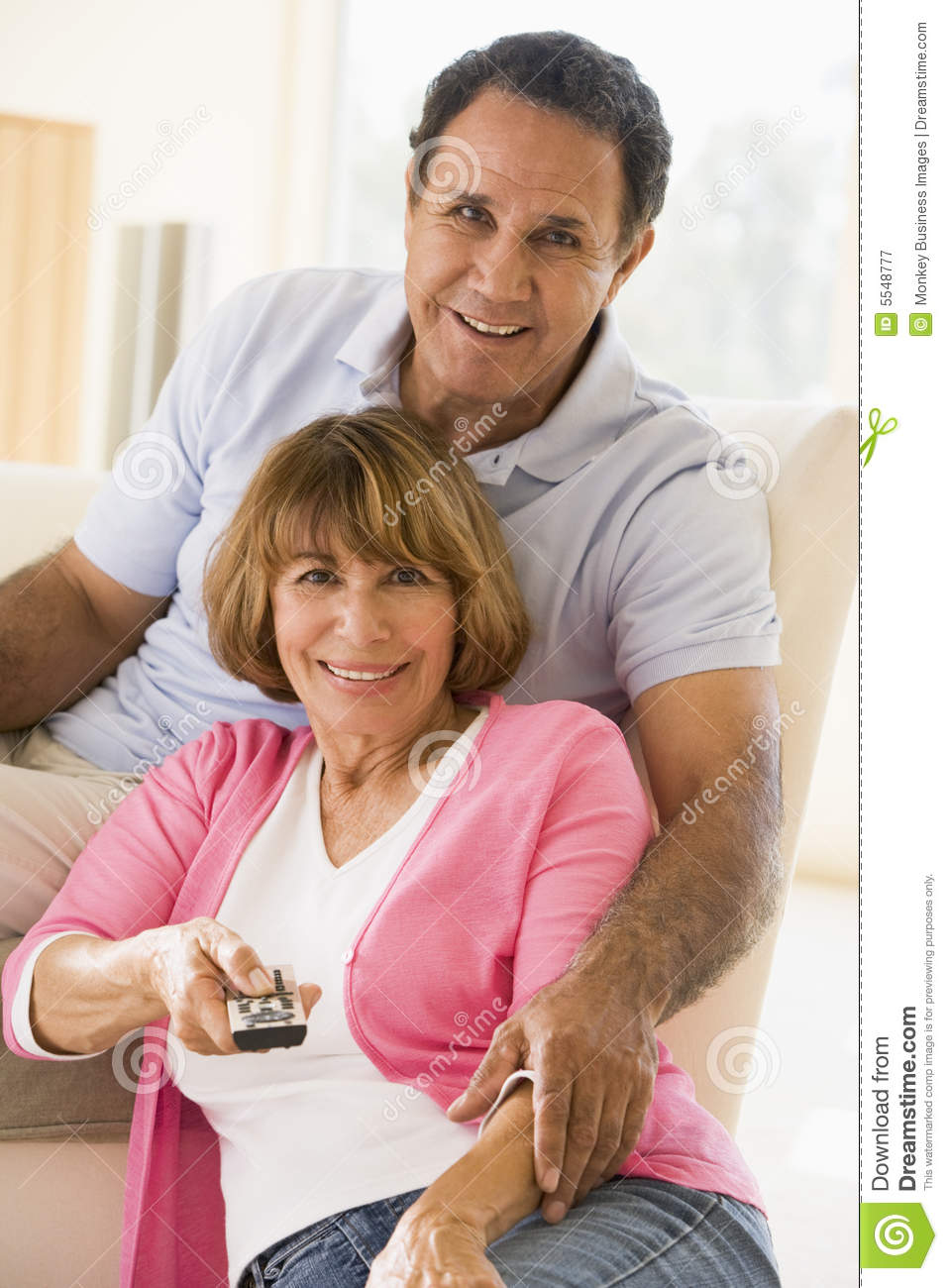 Control couple living remote room smiling