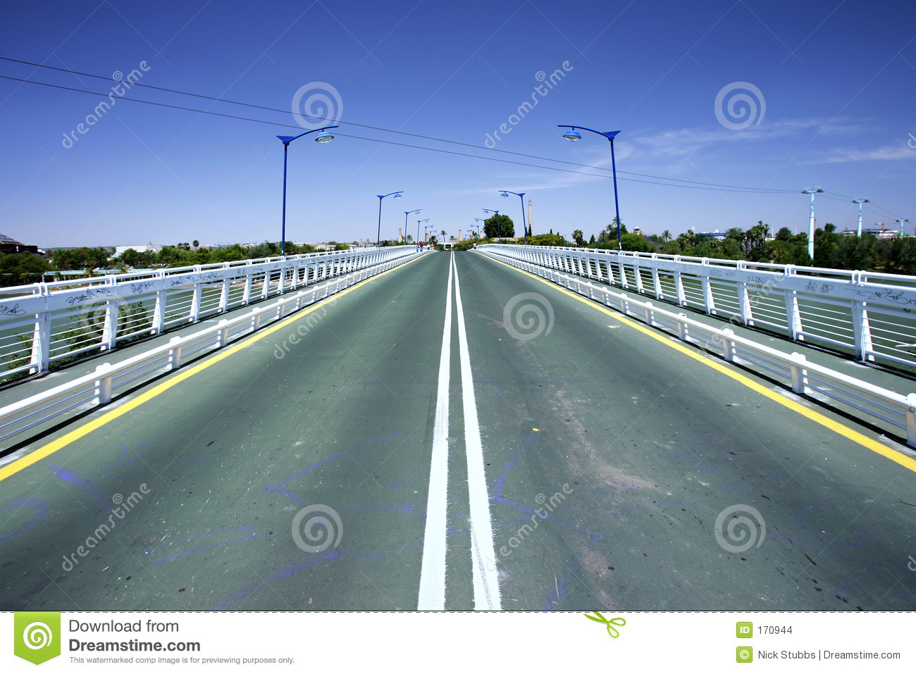 Converging lines of road on bridge