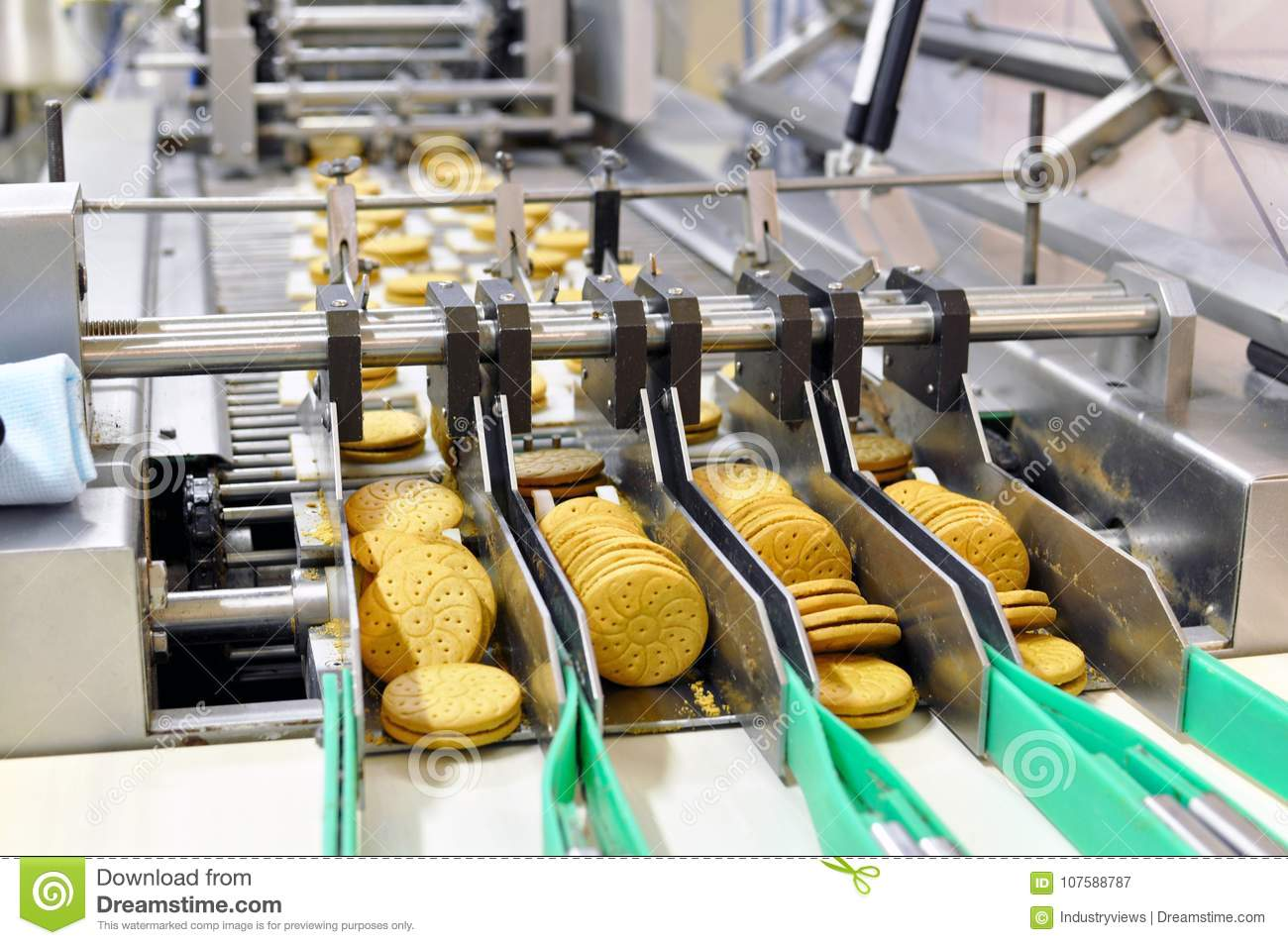 Conveyor Belt With Biscuits In A Food Factory Machinery
