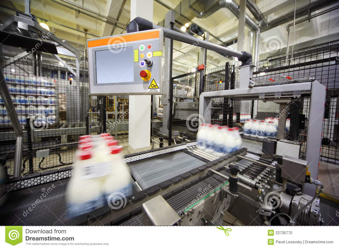 Conveyor with wrapped milk bottles at factory