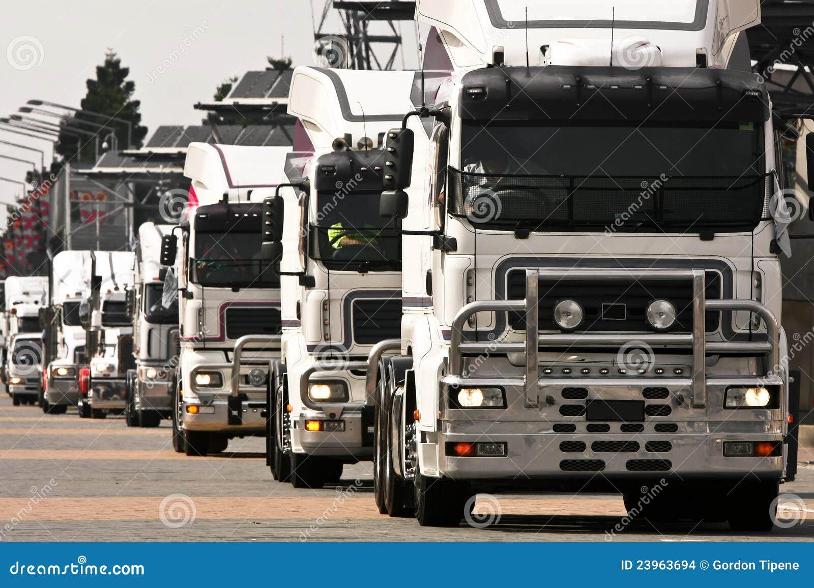 Convoy of white heavy trucks