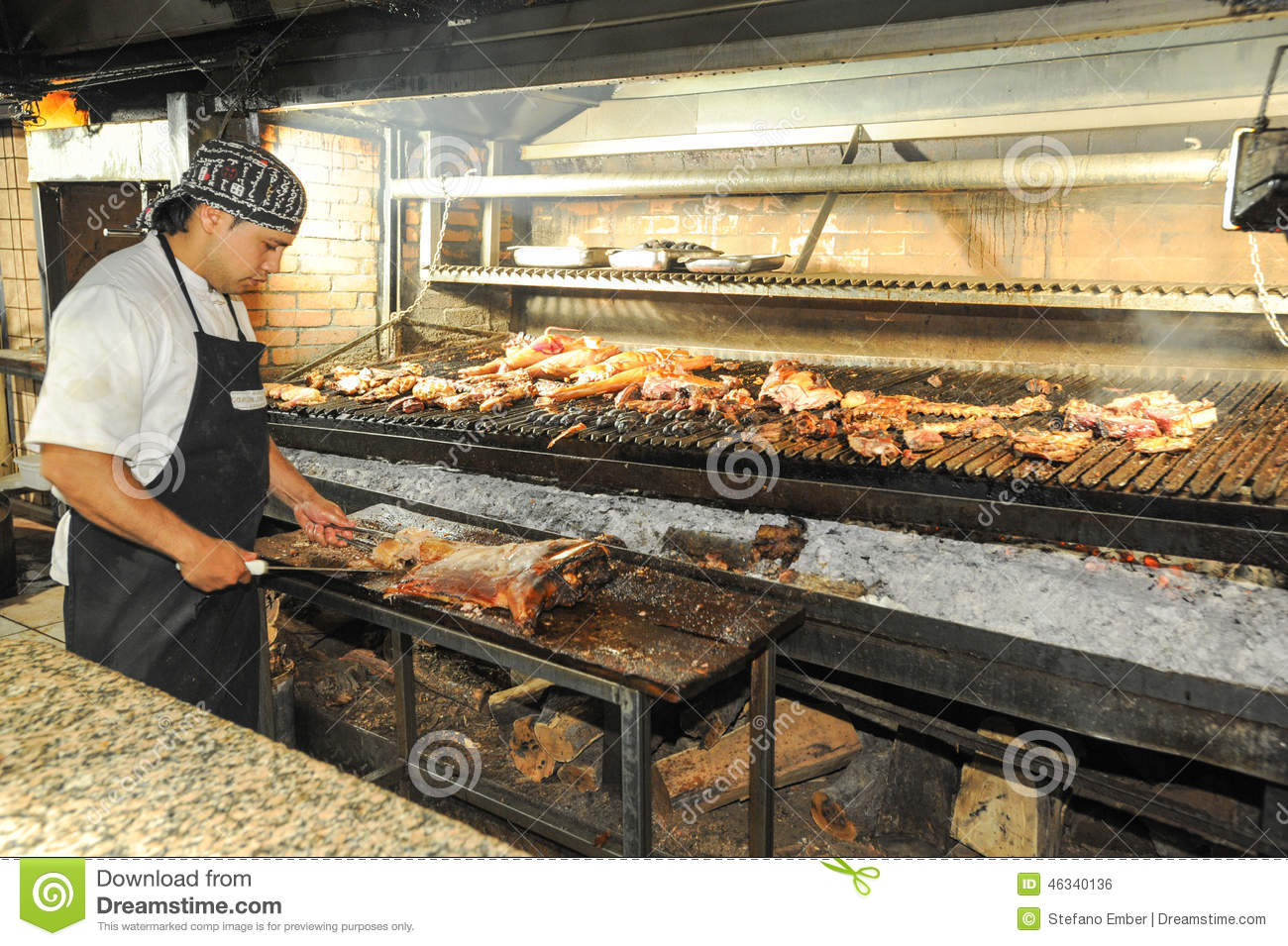 cook on the bbq grill at a restaurant of mendoza. Black Bedroom Furniture Sets. Home Design Ideas