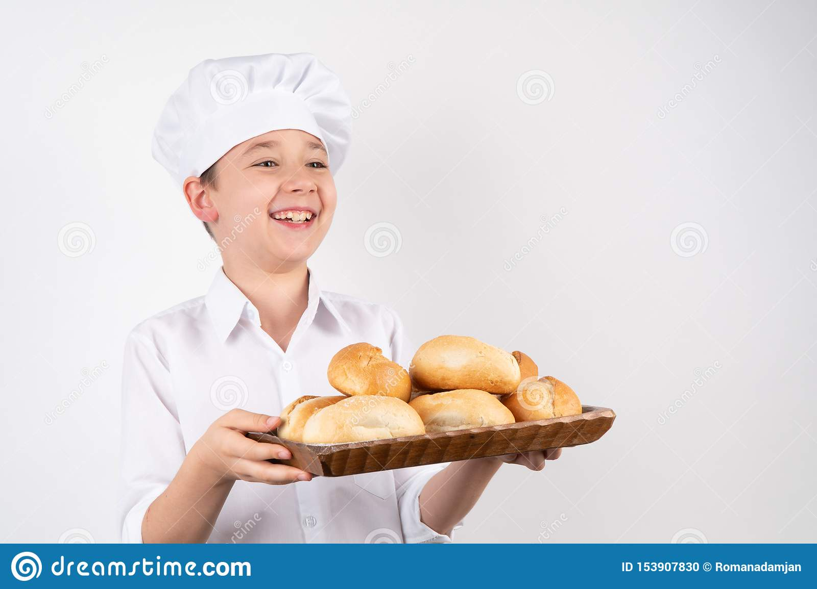 Cook Boy With Bread on white background, laughs