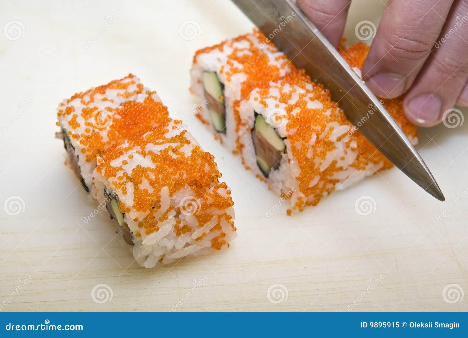 Cook on kitchen prepares Japanese susi