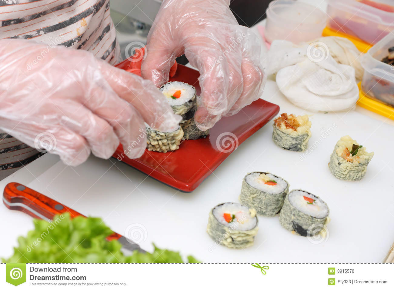 Cook in the kitchen serving japan susi on plate