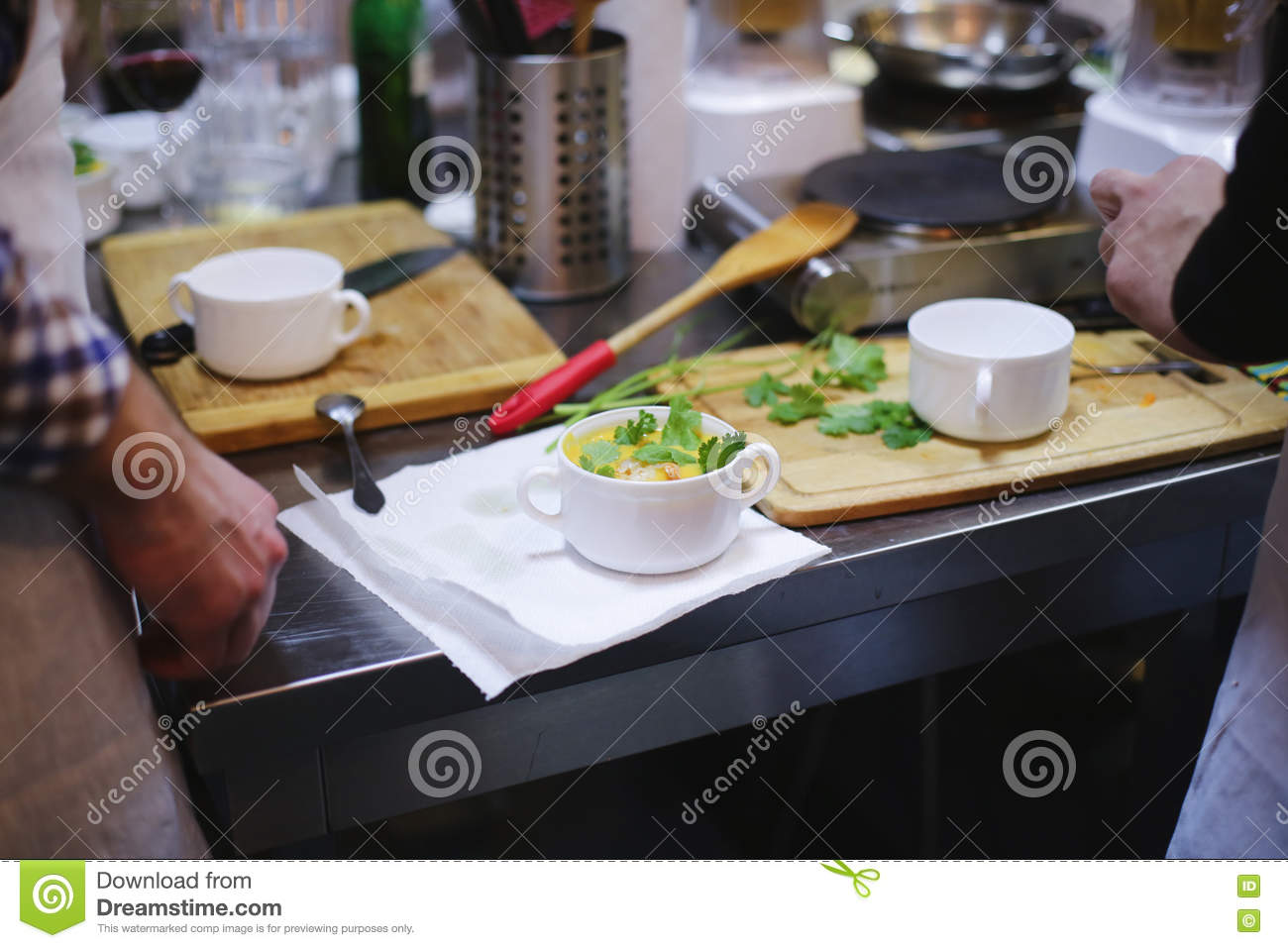 Cook in kitchen and table of food
