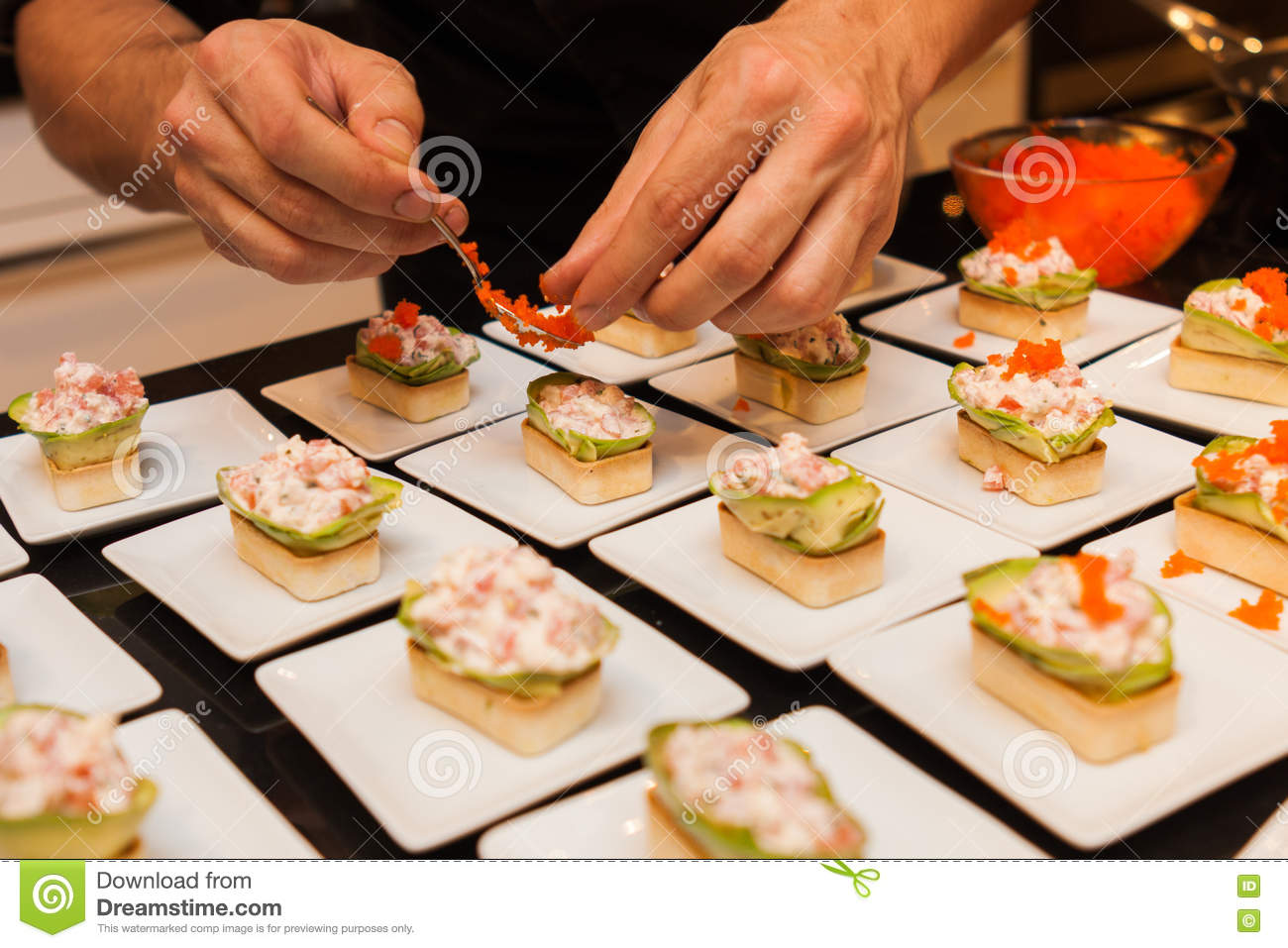 Cook prepared delicious gourmet canap starters on white for How to prepare caviar