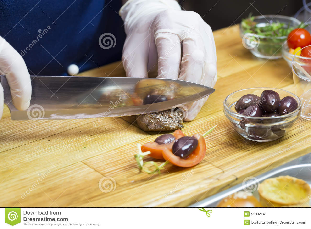 Cook prepares canapes stock photo image 51982147 for Canape kitchen