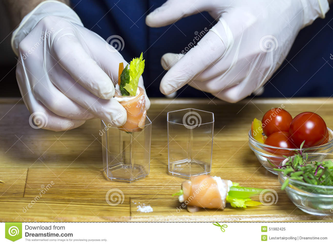 Cook prepares canapes stock photo image 51982425 for Restaurant canape
