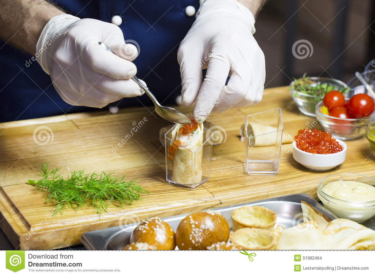 Cook prepares canapes stock photo image 51982464 for Canape kitchen