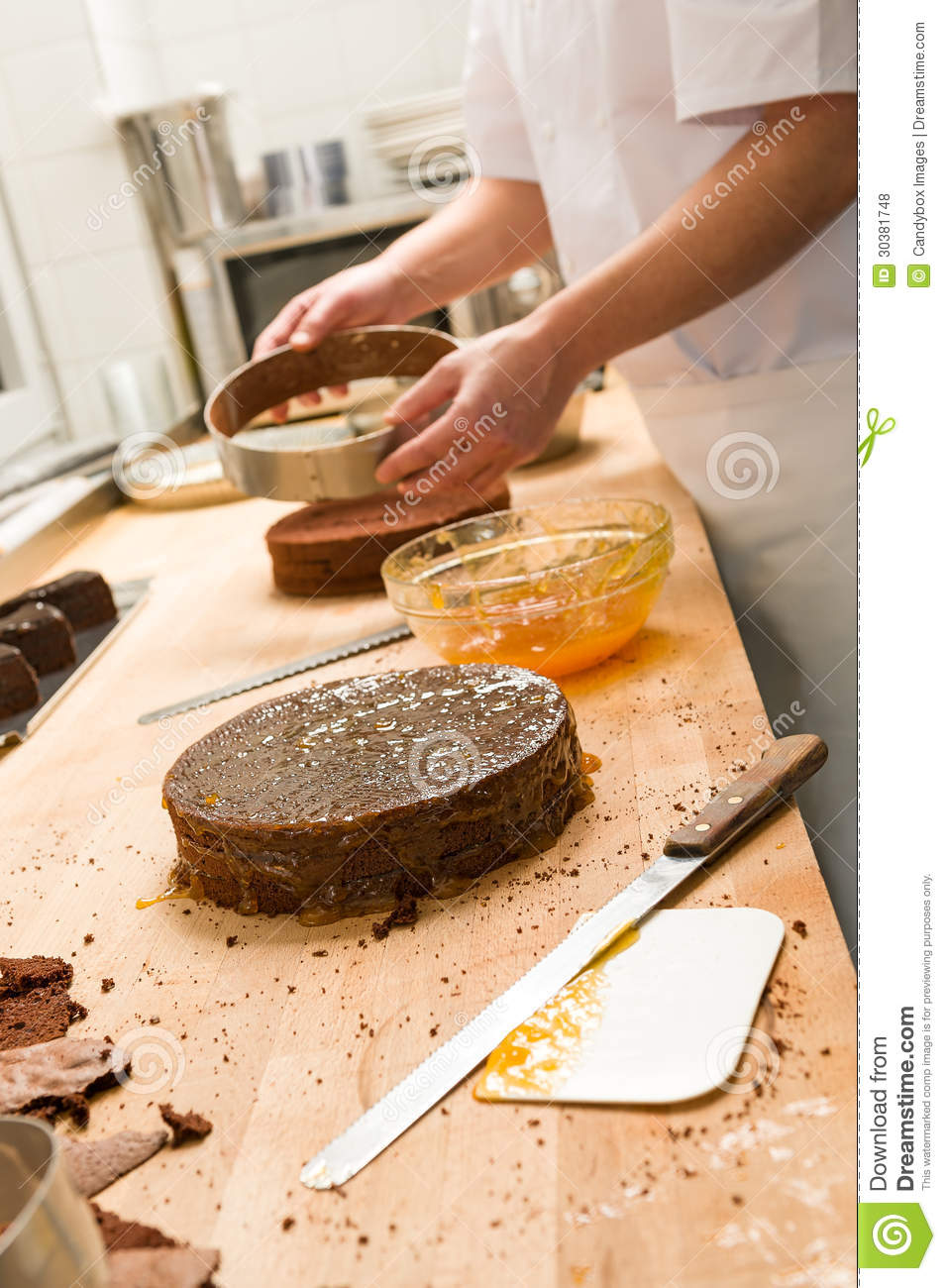 cook taking out cake from cake form stock photo image of food knife 30381748. Black Bedroom Furniture Sets. Home Design Ideas